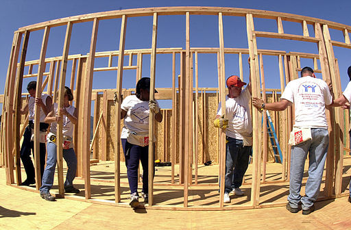 Volunteering to build homes for poor families
